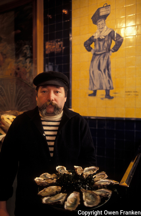Oysterman in a Paris seafood restaurant