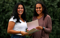 © Licensed to London News Pictures. 17/08/2017. LONDON, UK. <br /> TWINS RECEIVE 4A*s and 3A's BETWEEN THEM IN A LEVEL RESULTS<br /> Twins from Lady Eleanor Holles school, Anoushka Persson (L) and Lata Persson (R) react to receiving their A level results, between them achieving 4A*s and 3A's. Lata is going to Cambridge University to study Economics and Anoushka is going to Durham to study Spanish and History. Lady Eleanor Holles School in Hampton, south-west London achieved 96% of students passing with grades A*-B.<br /> Photo credit: LNP