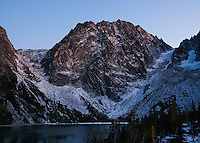 Dragontail Peak above Colchuck Lake in late afternoon, Washington Cascades, USA.