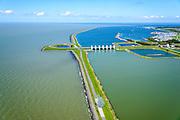 Nederland, Flevoland, Lelystad, 07-05-2015. Oostvaardersdijk, Houtribsluizen en begin van de Houtribdijk. Op de strekdam in de voorgrond de sculptuur &lsquo;Exposure&rsquo; van de Britse kunstenaar Antony Gormley.<br /> Oostvaardersdijk, Houtrib locks and beginning of the Houtrib dike.<br /> luchtfoto (toeslag op standard tarieven);<br /> aerial photo (additional fee required);<br /> copyright foto/photo Siebe Swart