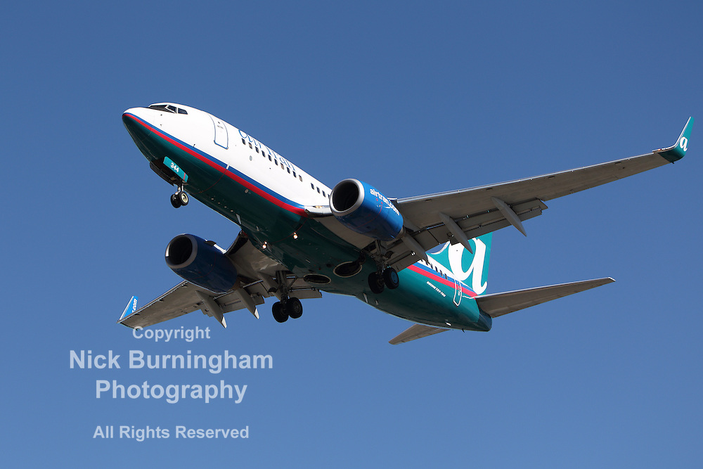 LOS ANGELES, CALIFORNIA, USA - JANUARY 28, 2013: An Airtran Boeing 737-700 lands at Los Angeles Airport on January 28, 2013. The plane seats 126 passengers with a range of 6,370 km