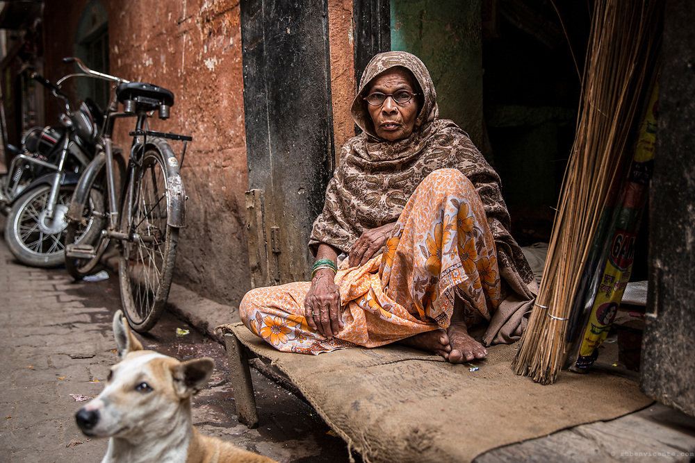 Lady sitting by the door. Varanasi, India