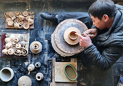 July 4, 2018 - China - Qinhuangdao, CHINA-The folk artist Liu Aimin makes earthernware pot in Qinhuangdao, north China's Hebei Province. (Credit Image: © SIPA Asia via ZUMA Wire)