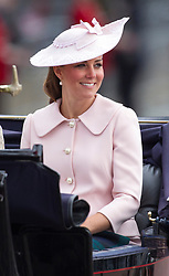 LONDON - UK - 15 JUNE 2013:  Kate, Duchess of Cambridge. <br /> Members of the British Royal Family join HM Queen Elizabeth for the annual Trooping The Colour Ceremony to mark the Queen's Official Birthday. The Queen and members of the family travelled by carriage to Horseguards for the ceremonial parade before joining her on the balcony of Buckingham Palace.<br /> The Duke of Edinburgh who normally accompanies the Queen was absent as he is still in hospital recovering from an operation.<br /> Photograph by Ian Jones.