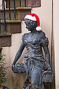 Christmas decorations on a statue in Savannah, GA.