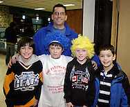 Cameron Benoit, 9 (in Gems jersey,) son of Gems legend Moe Benoit and some friends stop for a photo after the Dayton Gems beat the Flint Generals 3-1 at Hara Arena, Sunday, November 22, 2009.