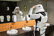 UNITED KINGDOM, London: 25 May 2019 <br /> A cosplayer dressed as a Stormtrooper adjusts his mask after a much needed toilet break on the second day of MCM London Comic Con. Thousands of cosplay enthusiasts will come to the ExCeL Centre this weekend to enjoy the convention.