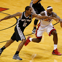 Jun 20, 2013; Miami, FL, USA; Miami Heat small forward LeBron James (6) and San Antonio Spurs small forward Kawhi Leonard (2) battle for a loose ball during the second quarter of game seven in the 2013 NBA Finals at American Airlines Arena. Mandatory Credit: Derick E. Hingle-USA TODAY Sports
