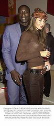 Designer OZWALD BOATENG and his wife GUNNEL, at a party in London on 16th October 2001.	OTD 95
