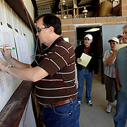 LAS VEGAS, NEVADA, November 12, 2007: Contestants from around the world gathered in Las Vegas, Nevada on November 12, 2007 to race their pigeons in the Las Vegas Classic. Betting sheets with various odds are placed on the wall for participants and others to pen their wagers.