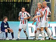 30-08-2008 VOETBAL:WILLEM II:AJAX:TILBURG<br /> Frank Demouge heeft wellicht voor het laatst gescoord in Tilburgse dienst. Schenkel en Boutahar vieren het ingetogen feestje mee<br /> Foto: Geert van Erven