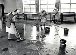 Cleaning up after dinnertime, primary school Birmingham, UK 1987