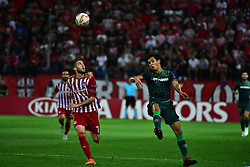 September 20, 2018 - Piraeus, Attiki, Greece - Kostas Fourtounis (no 7) of Olympiacos tries to avoid  Aissa Mandi (no 23) of Real Betis. (Credit Image: © Dimitrios Karvountzis/Pacific Press via ZUMA Wire)