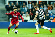 Mohamed Salah (#11) of Liverpool takes on Paul Dummett (#3) of Newcastle United during the Premier League match between Newcastle United and Liverpool at St. James's Park, Newcastle, England on 4 May 2019.