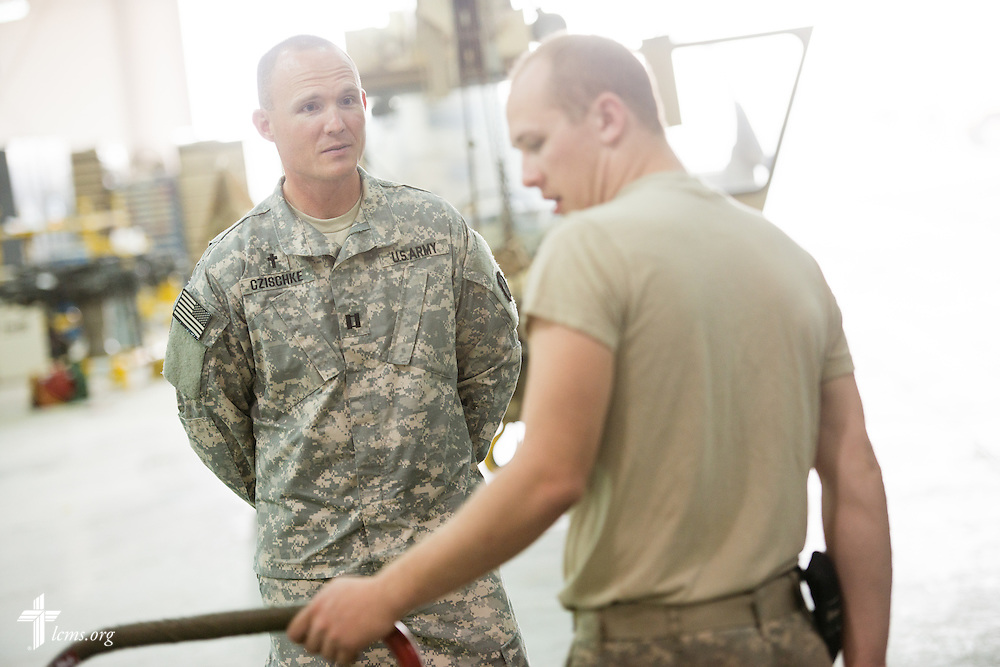 Army Capt. Chad Czischke, chaplain, visits with a fellow soldier on Sunday, March 22, 2015, at Camp Buehring in Kuwait. LCMS Communications/Erik M. Lunsford