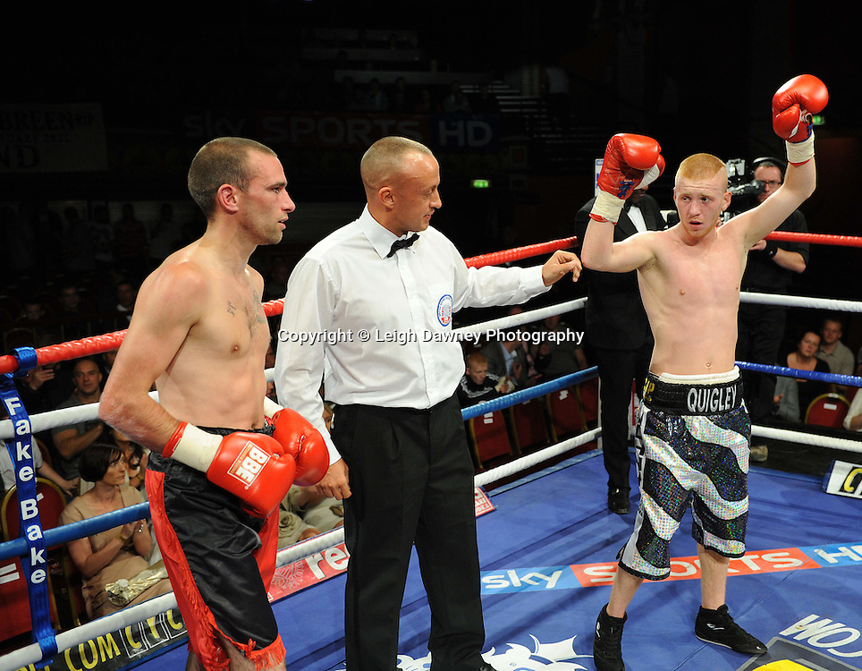 John Quigley (black/silver shorts) defeats Steve Gethin in a Super Featherweight contest at Olympia, Liverpool on the 11th June 2011. Frank Maloney Promotions.Photo credit: Leigh Dawney 2011