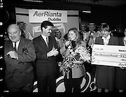 5,000,000th Passenger Through Dublin Airport. (T12).1989..22.12.1989..12.22.1989..22nd December 1989..The date,Friday,22nd December 1989 will be remembered as an historic day in Irish Aviation as Aer Rianta celebrated the 5millionth passenger to fly through Dublin Airport in one year. The Lucky passenger, Nicola Wynne, arrived at 10AM from Germany and was welcomed to Dublin Airport by General Manager,Tom Cullen...Image shows a stunned, Nicola Wynne,Boyle, Roscommon, celebrating with champagne as she is presented with a cheque for £2000 as she had become the 5millionth passenger through Dublin Airport in 1989. Tom Cullen, General Manager, Aer Rianta and Terence McGowan,Manager Airport Services,Delta Airlines are included in the picture.