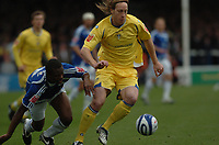 Photo:Tony Oudot/Richard Lane Photography. Peterborough United v Leeds United. Coca-Cola Football League One. 04/10/2008. Luciano Becchio of Leeds with Gabriel Zakuani of Peterborough.