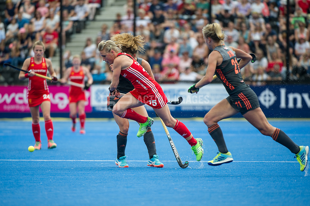England's Alex Danson goes past Lauren Stam and Maria Verschoor of the The Netherlands. England v The Netherlands, Lee Valley Hockey and Tennis Centre, London, England on 11 June 2017. Photo: Simon Parker