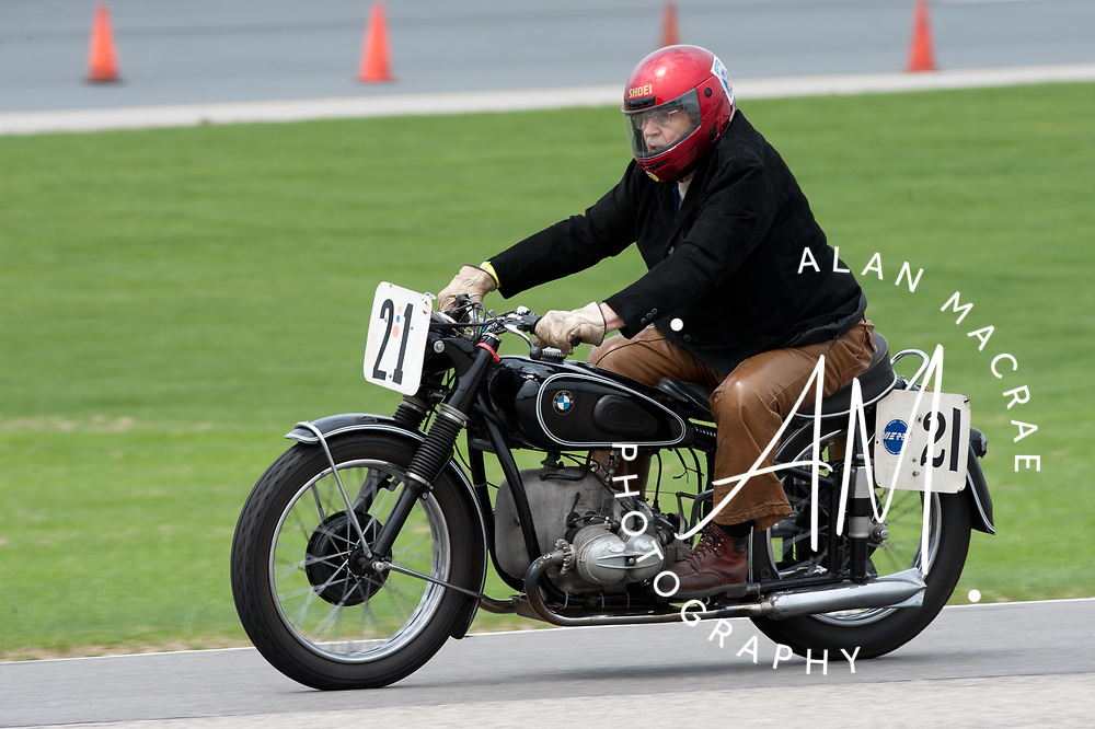 Stan Myers of Tafton, Pennsylvania makes his way around the course on his 1950 BMW 500 during the US Vintage Motorcycle Grand Prix at New Hampshire Motor Speedway.  Myers, who will be 87 in August, has been racing motorcycles since 1946.  (Alan MacRae/for the Citizen)