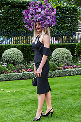 Ascot, UK. 20 June, 2019. A racegoer wearing a fancy hat attends Ladies Day at Royal Ascot.