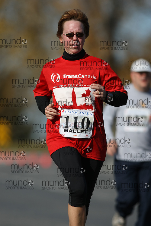 (Ottawa, ON---18 October 2008) JEANNIE MALLET competes in the 2008 TransCanada 10km Canadian Road Race Championships. Photograph copyright Sean Burges/Mundo Sport Images (www.msievents.com).