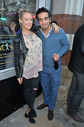 ELLIE SHEPHERD and CYRUS MOLAVI at a private view of an exhibition entitled 'All Shook Up' - by Natasha Archdale: A Retrospective held at 90 Piccadilly, London on 23rd April 2015.