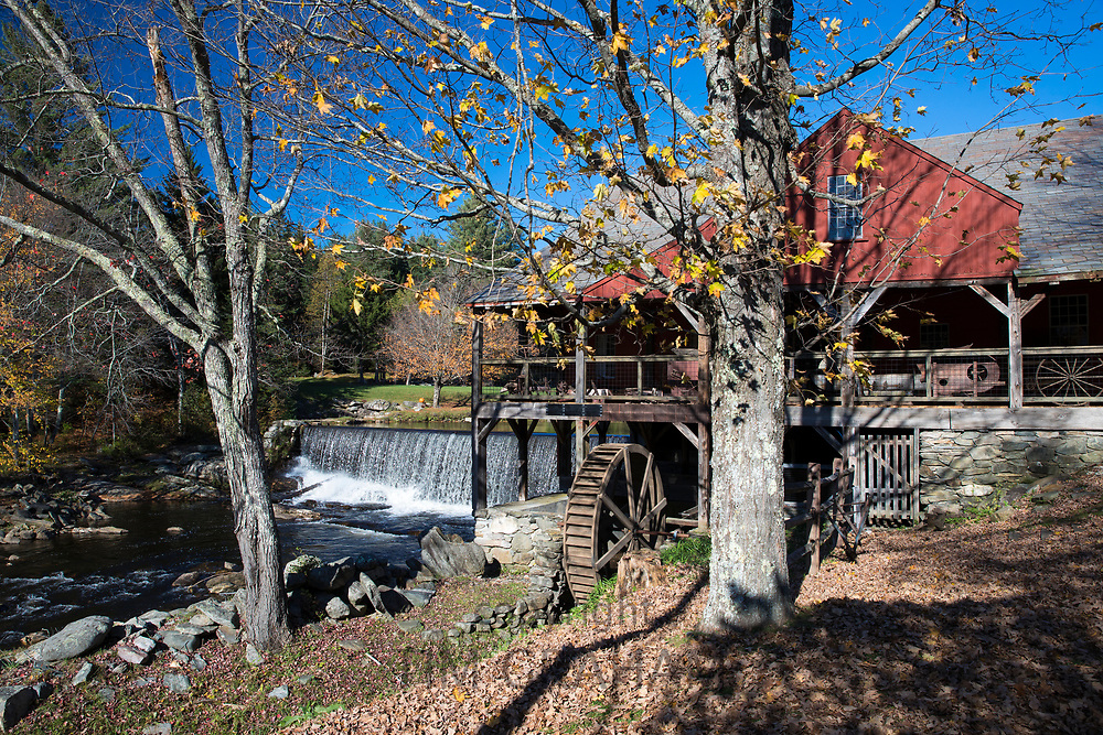 Grist Mill and The Old Mill Museum by the West River waterfall in Southern Vermont, New England, USA
