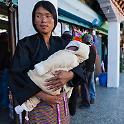 Bhutanese woman with baby in the center town, Thimphu, Bhutan, Asia