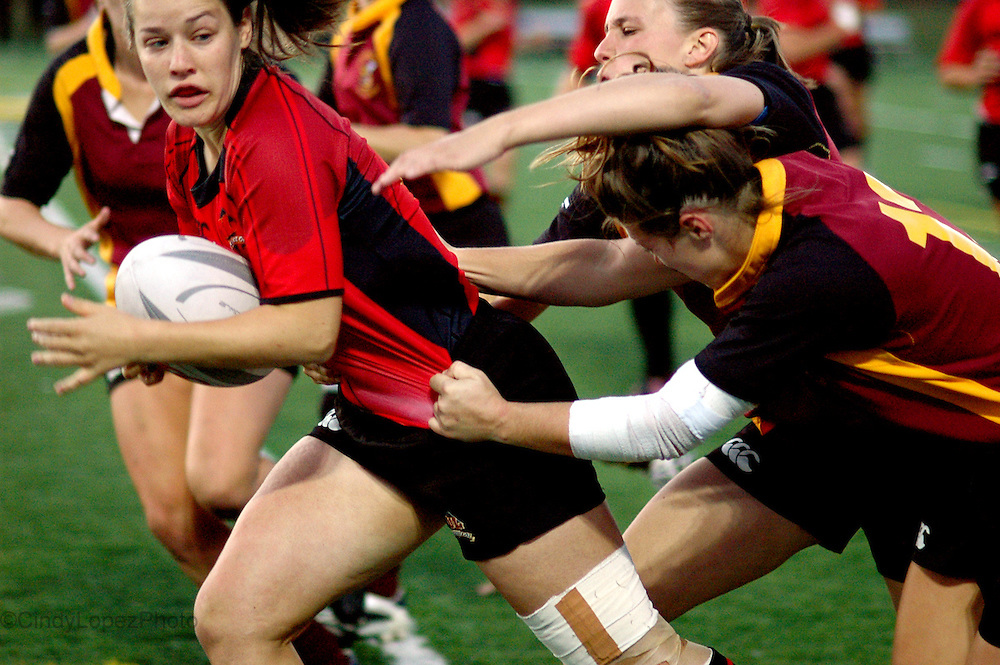 The Concordia Women's Rugby team head to head against rivals the Laval Rouge et Or. (Published in The Concordian. September 2009).