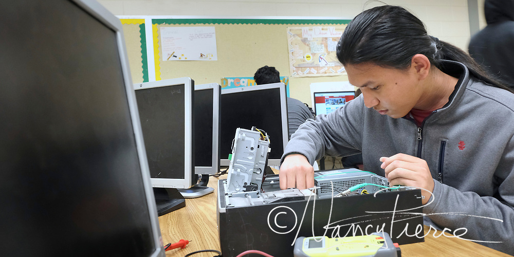 Independence High School -- This is to llustrate Computeer Engineering. The students are working with computer components.