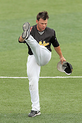 06 July 2013:  Mike Swartz stretches to warm up during a Frontier League Baseball game between the Gateway Grizzlies and the Normal CornBelters at Corn Crib Stadium on the campus of Heartland Community College in Normal Illinois