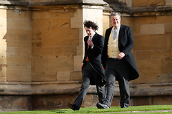 Stephen Fry and husband Elliott Spencer arrive to attend the wedding for the wedding of Princess Eugenie to Jack Brooksbank at St George's Chapel in Windsor Castle.