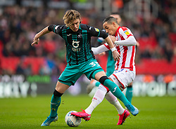 STOKE-ON-TRENT, ENGLAND - Saturday, January 25, 2020: Swansea City's Conor Gallagher (L) and Stoke City's Tom Ince during the Football League Championship match between Stoke City FC and Swansea City FC at the Britannia Stadium. (Pic by David Rawcliffe/Propaganda)