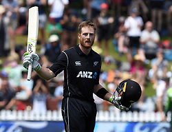 New Zealand's Martin Guptill salutes his 100 against Pakistan in the fifth one day International Cricket match, Basin Reserve, Wellington, New Zealand, Friday, January 19, 2018