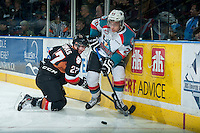 KELOWNA, CANADA - FEBRUARY 28: Gage Quinney #20 of Kelowna Rockets checks Ben Thomas #27 of Calgary Hitmen at the boards on February 28, 2015 at Prospera Place in Kelowna, British Columbia, Canada.  (Photo by Marissa Baecker/Shoot the Breeze)  *** Local Caption *** Gage Quinney; Ben Thomas;