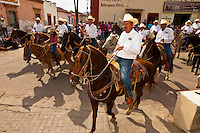 Horseback riders parade around the town square on the Celebration of San Sebastian, Concordia (near Mazatlan), Sinaloa, Mexico