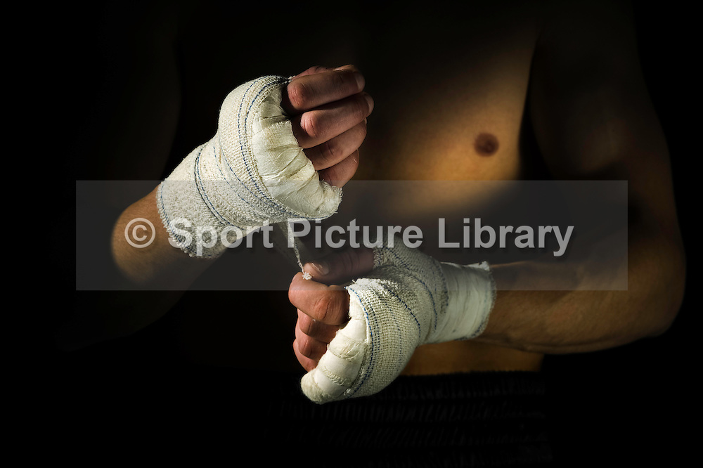 Boxer, Claude De Lange, applying hand wraps.