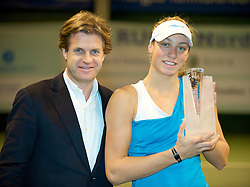 OSLO, NORWAY - Saturday, December 19, 2009: Tournament Director Anders Borg presents the  trophy to Yanina Wickmayer after the Ladies' Final at the NRP Rubik Nordic Masters 2009 tournament at the Riksanlegget. (Pic by David Rawcliffe/Propaganda)
