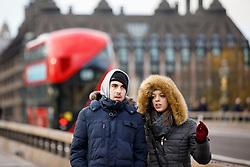 © Licensed to London News Pictures. 30/11/2017. London, UK. People walk in central London during a light snowfall on Thursday, 30 November 2017. Photo credit: Tolga Akmen/LNP