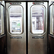 The double doors shot from inside the NYC subway train.