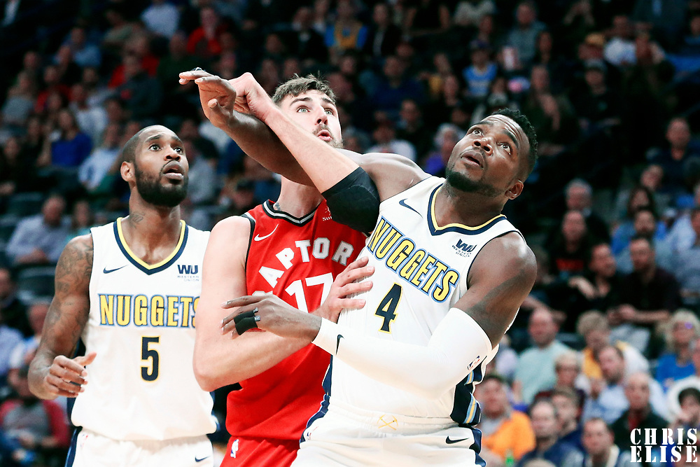 01 November 2017: Toronto Raptors center Jonas Valanciunas (17) vies for the rebound with Denver Nuggets forward Paul Millsap (4) and Denver Nuggets guard Will Barton (5) during the Denver Nuggets 129-111 victory over the Toronto Raptors, at the Pepsi Center, Denver, Colorado, USA.