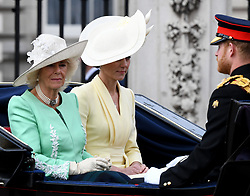 Camilla, Duchess of Cornwall, Catherine, Duchess of Cambridge and Prince Harry, Duke of Sussex ride in an open carriage during Trooping the Colour in London