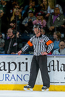 KELOWNA, CANADA - DECEMBER 27: Referee Nick Swaine, stands on the ice at the boards between the Kelowna Rockets and the Kamloops Blazers on December 27, 2016 at Prospera Place in Kelowna, British Columbia, Canada.  (Photo by Marissa Baecker/Shoot the Breeze)  *** Local Caption ***