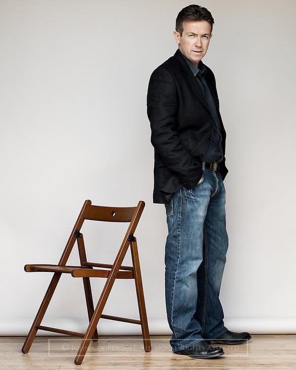 Portrait of actor Mark Cox.