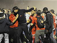 Football - 2019 / 2020 EFL Carabao (League) Cup - Crawley Town vs. Stoke City<br /> <br /> Crawley manager, Gabriele Cioffi celebrates with the fans as they run onto the pitch to celebrate after the winning penalty in the shoot out, at The Peoples Pension Stadium (Broadfield).<br /> <br /> COLORSPORT/ANDREW COWIE
