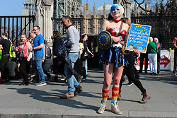 © Licensed to London News Pictures. 29/03/2019. London, UK. An anti-Brexit protester outside Parliment. MPs will vote on whether to accept Prime Minister Theresa May's withdrawal agreement for a third time today. Photo credit: Rob Pinney/LNP