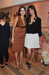 Left to right, YASMIN MILLS and LISA BILTON at a ladies lunch in aid of Mothers4Children hosted by Carmelbabyandchild at 259 Pavillion Road, London SW1 on 30th June 2011.