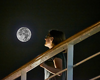 Viewing the Full Moon from the aft deck of the MV World Odyssey. Composite image taken with a Fuji X-T1 camera and 55-200 mm VR lens (ISO 6400, 200 mm, f/5.6, 1/30 sec)