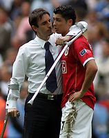 Photo: Paul Thomas.<br /> Chelsea v Manchester United. The FA Cup Final. 19/05/2007.<br /> <br /> Injured Utd captain Gary Neville consoles a dejected  Cristiano Ronaldo (R).